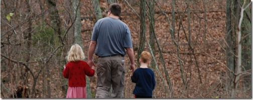Father and children on a walk