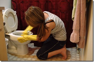Woman cleaning toilets